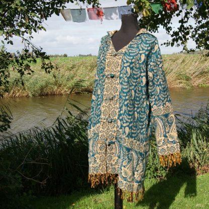 turquoise vest met capuchon