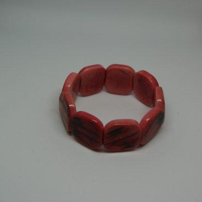 Tagua armband van rood/roze schijven